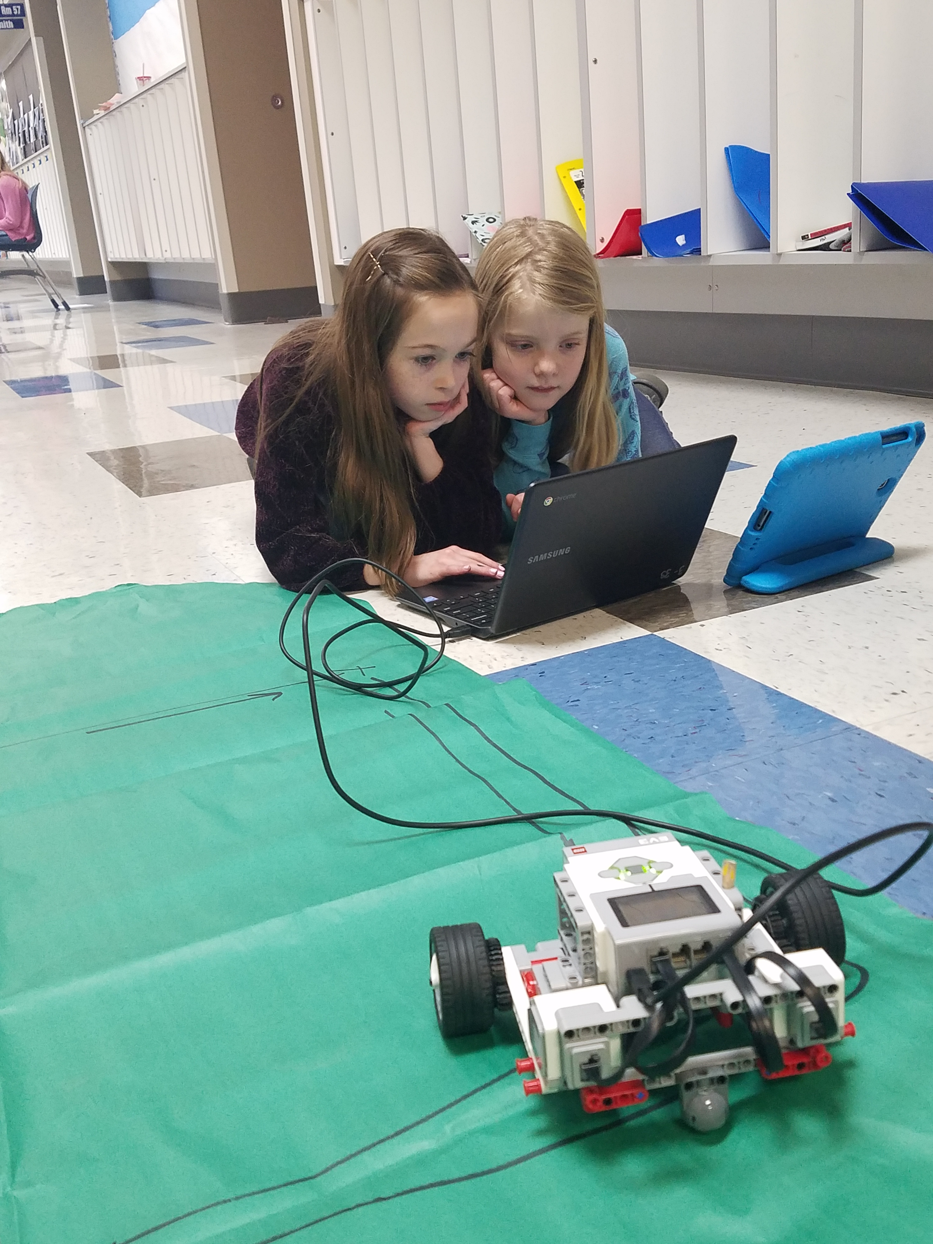 4th Grade students show off their robotics project.