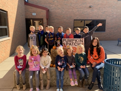 Kolling student teacher, Miss Geist, creates a pumpkin patch field trip for her students in the Kolling courtyard.