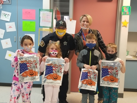 SRO, Nick Stammate, visits some Kolling students to teach them about Halloween safety.